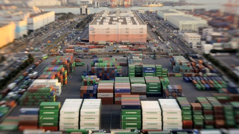 Japan - March 2011: High elevation time lapse view of traffic and commercial activity at a busy Japanese Cargo Container Port in Odaiba, Tokyo, Japan in March, 2011