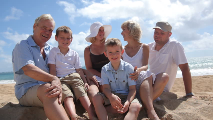 Portrait of multi-generation family at beach together