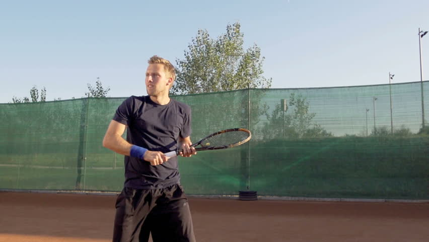 Slow Motion Shot Of Professional Tennis Player Hitting Forehand And Expressing