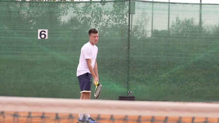 Slow Motion Shot Of A Young Tennis Player Throwing And Catching Tennis Ball And