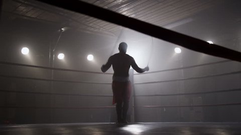 Boxer jumping rope in boxing ring