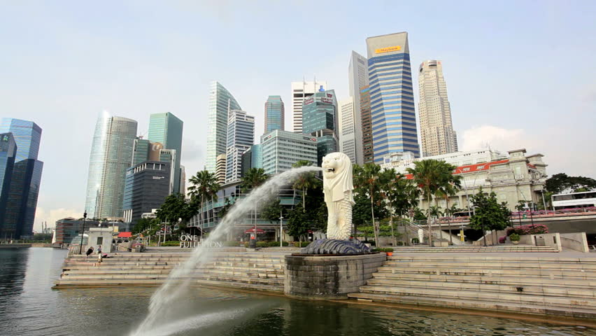 Singapore - April 2012: The Merlion Statue fountain with the City Skyline, Marina Bay, Singapore in April, 2012