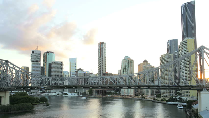 Australia - April 2012: Time lapse at sunset with Story Bridge and Brisbane city skyline