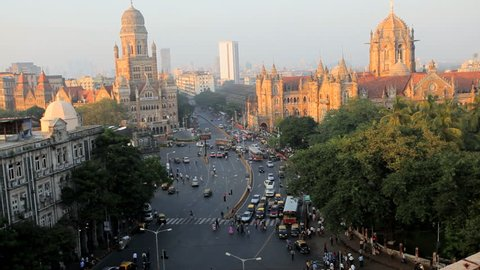 High angle view of pedestrian and vehicle traffic congestion at central Mumbai Heritage buildings and Municipal Corporation near Victoria Terminus, Mumbai, India in January, 2011