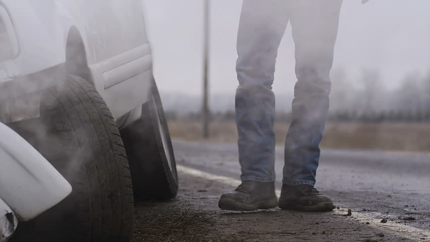 The victim of an auto accident gets out of his truck to assess the damage. Medium shot. | Shutterstock HD Video #4680056