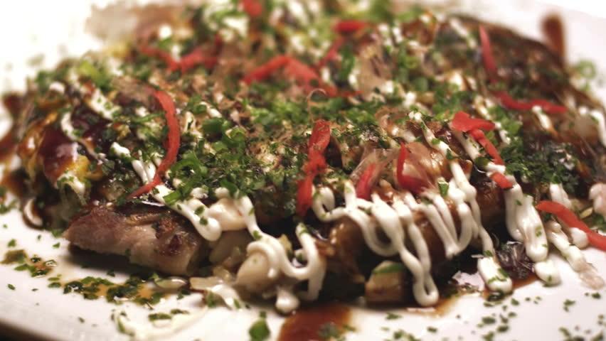 Colorful plate of Okonomiaki. Close up shot.