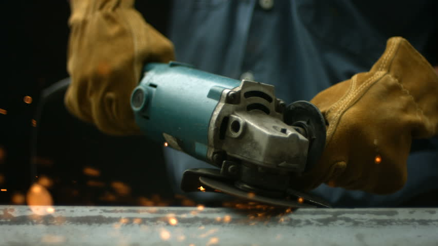 Worker using industrial grinder, slow motion | Shutterstock HD Video #4696286
