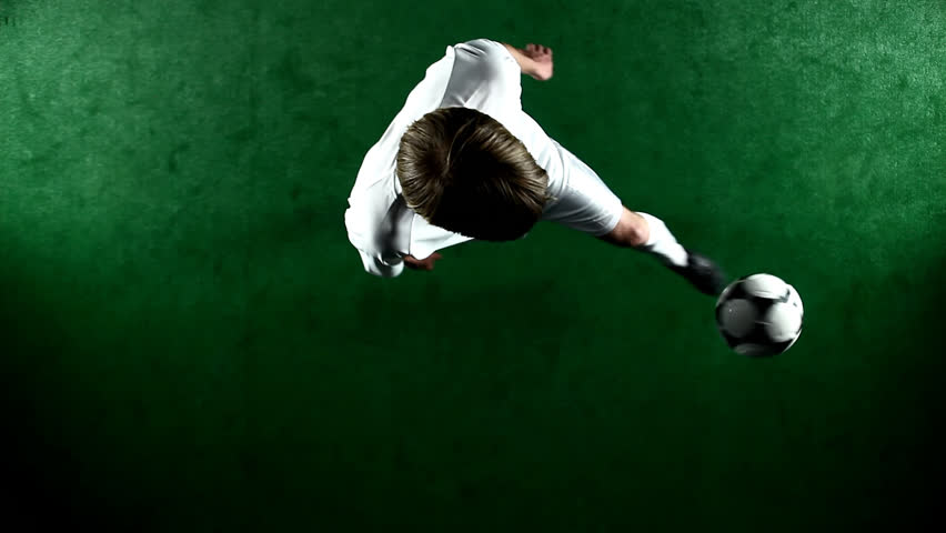 Over head view of a soccer player juggling and doing tricks with the ball | Shutterstock HD Video #4706966