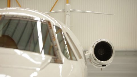 Right to left pan closeup shot of a grounded Cessna Citation VII indoors. Shot on a Canon 5D MK II with a 70-200mm f2.8 zoom lens.