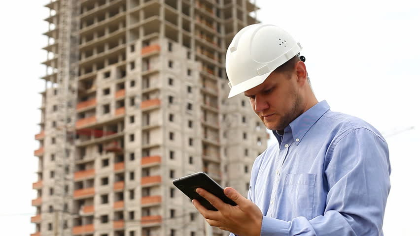Construction engineer with the tablet. pictures of the construction site | Shutterstock HD Video #4723106