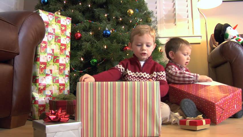 video de stock de two young boys opening christmas presents 4723856 shutterstock