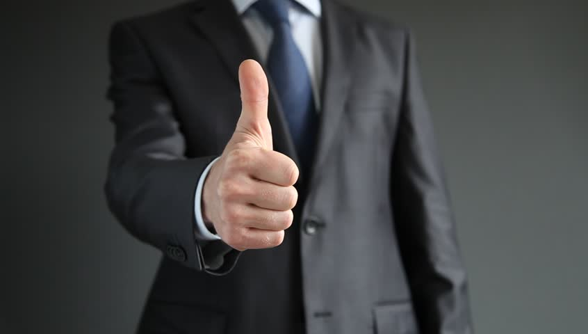 Businessman showing thumbs up - closeup shot