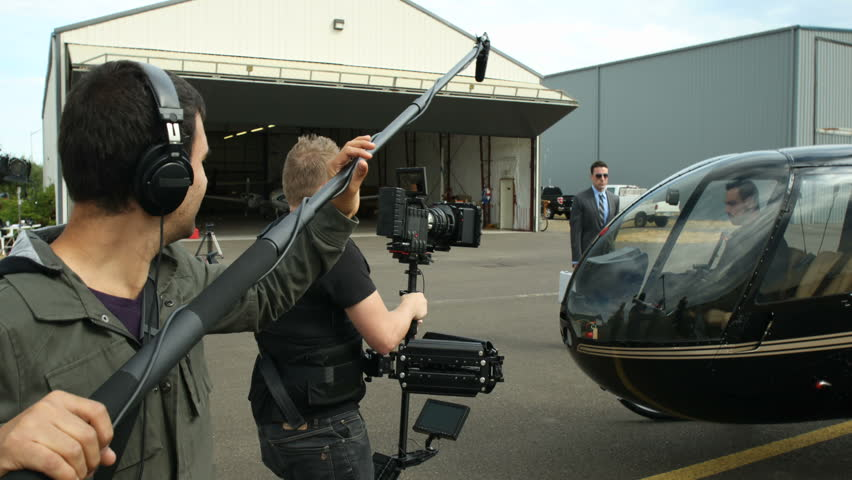 Behind the scenes, man gets into helicopter