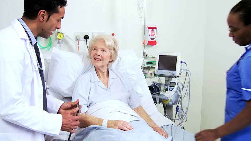 Male cardiologist using wireless digital tablet technology to discuss treatment options with an older patient #4760006