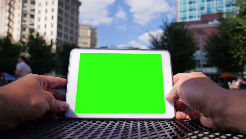A man uses a tablet computer outside at Market Square in downtown Pittsburgh