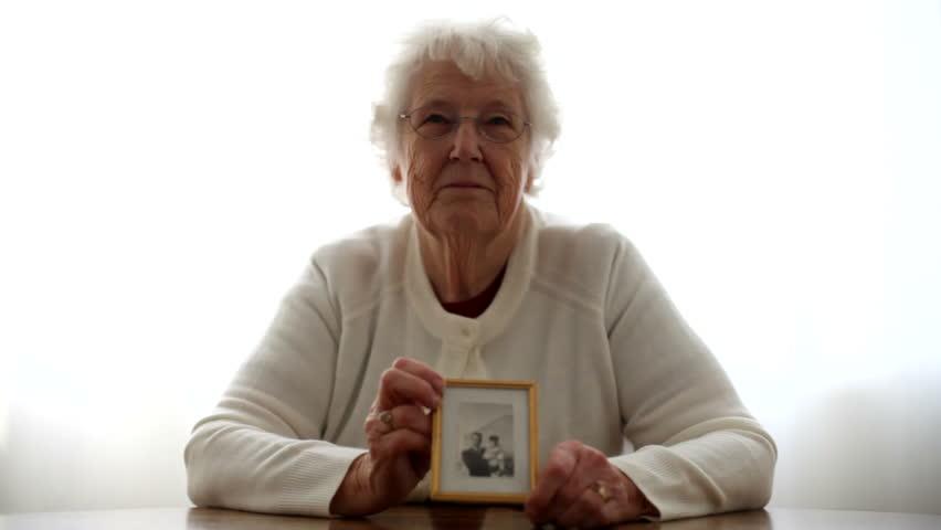 Portrait of senior woman holding a picture
