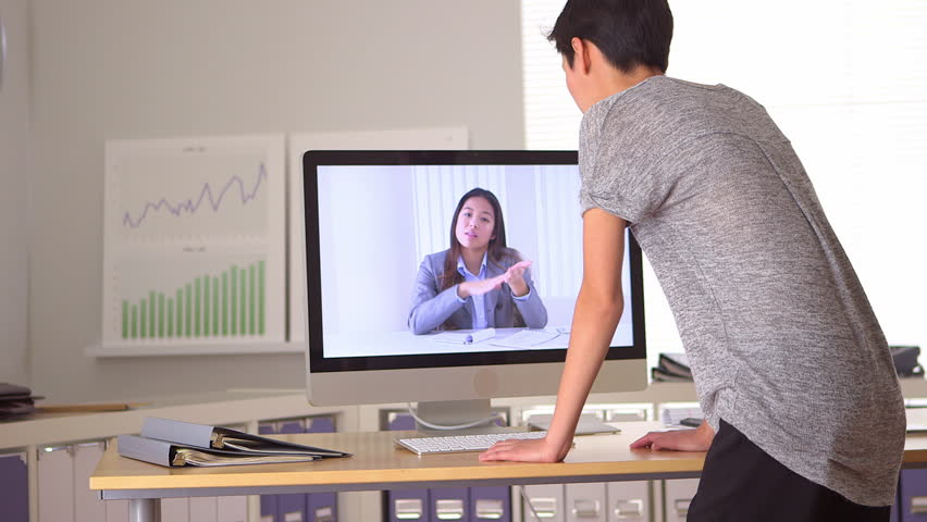 Two Chinese women engaging in video conference