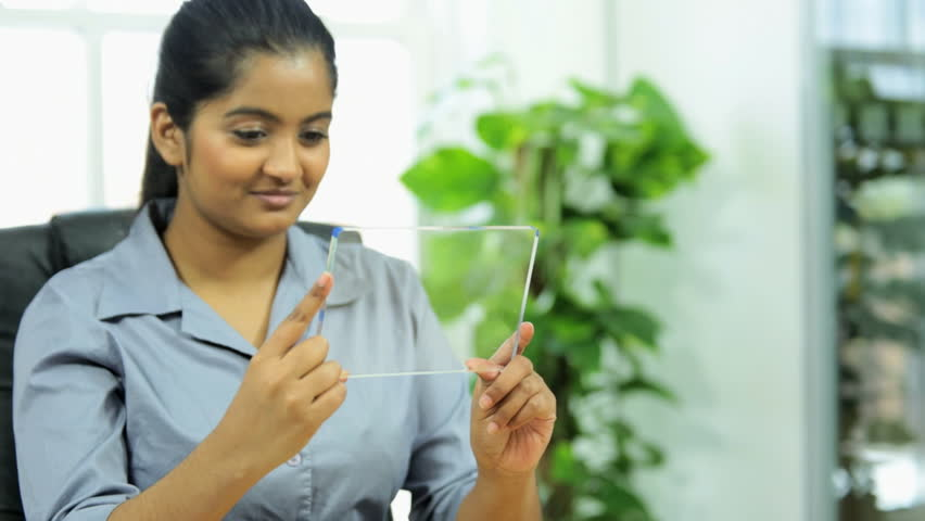 Young female business executive using modern technology to participate in a video business call | Shutterstock HD Video #4792166