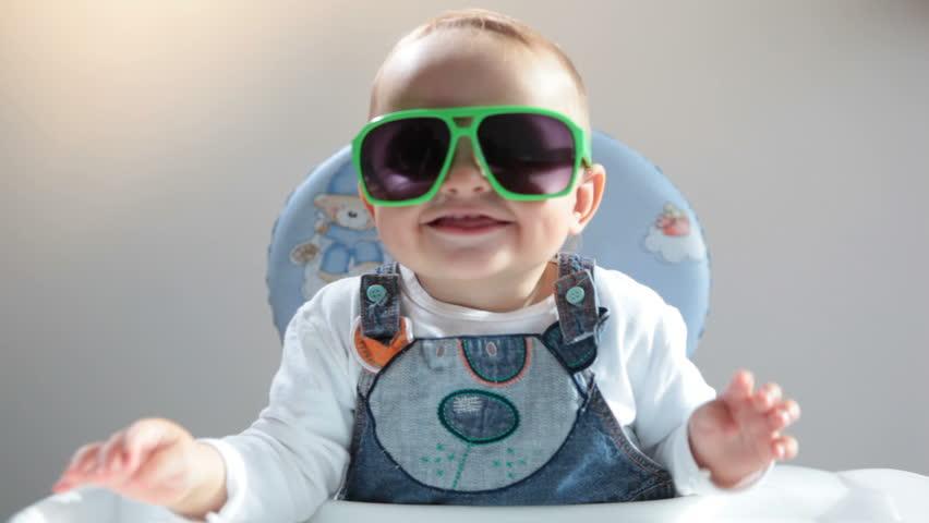 Baby in sunshades | Shutterstock HD Video #4792796