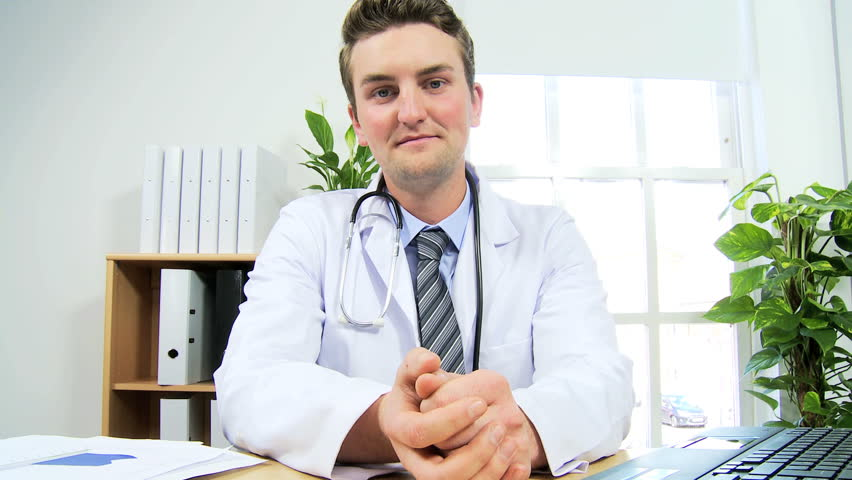 Caucasian Male Doctor Video Conference Call Discussing Drug Research