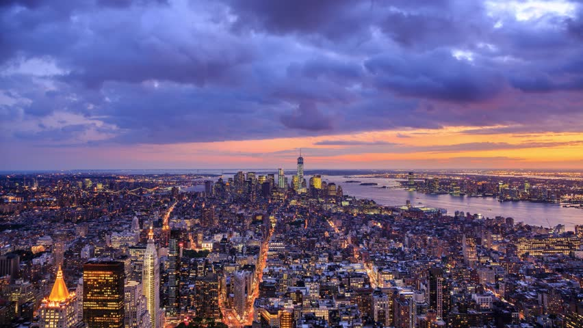 New York City Manhattan aerial panorama cityscape skyline. Transition from sunset to night. Timelapse.