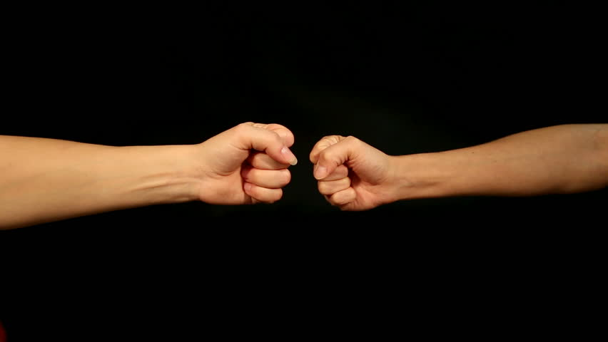 two female hands are playing rock, paper, scissors