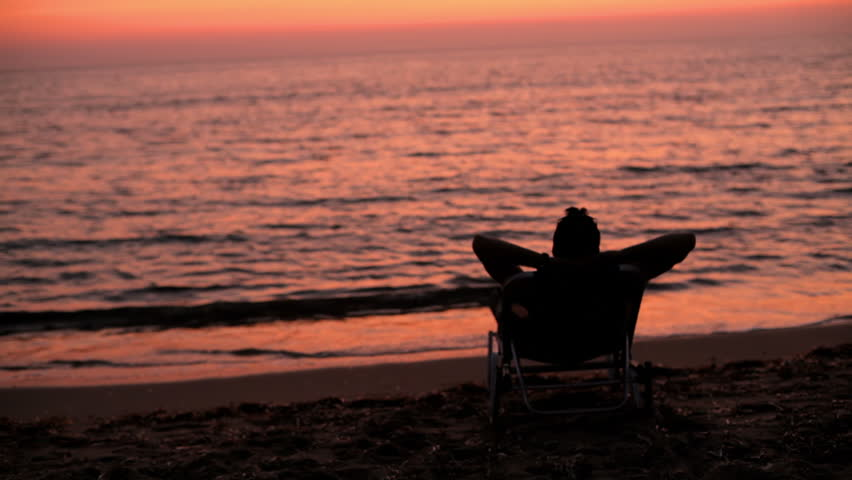 Stock video of a man sits in beach chair | 4821326 ...