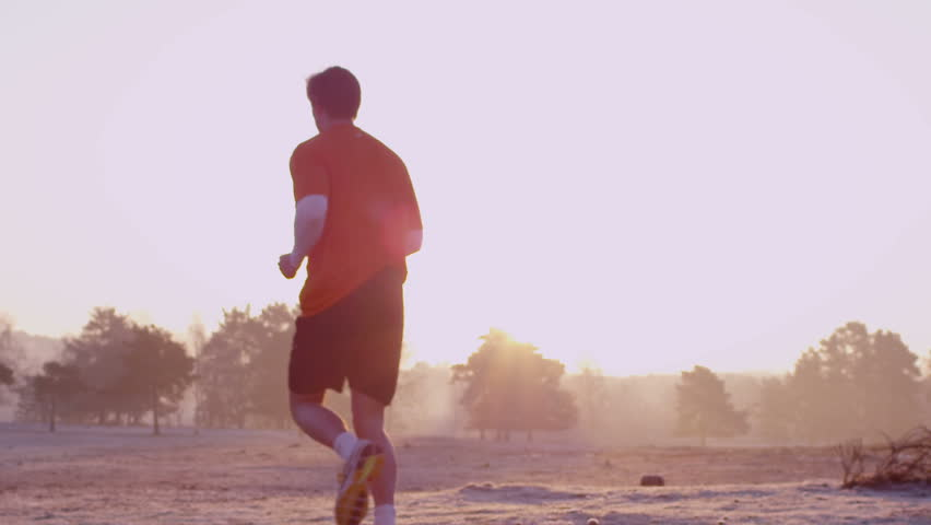 Jogger running through park, slow motion #4821506