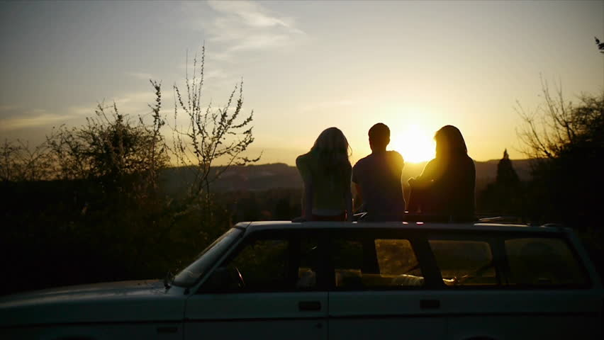 Teens Watching Sunset On Top Of Car (Flare)