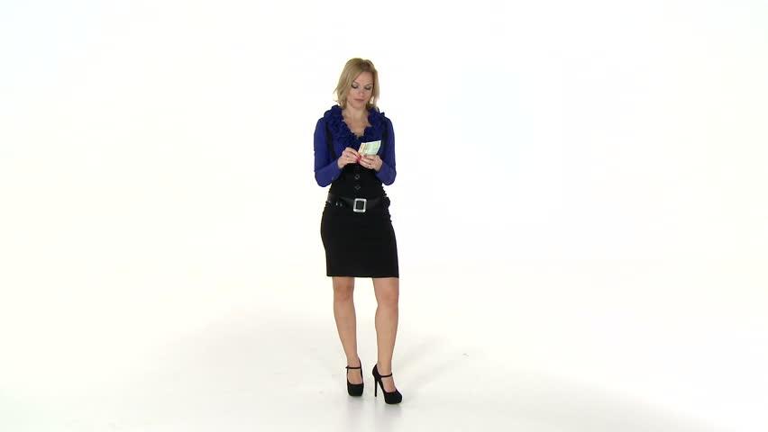 Businesswoman spending money carelessly. High definition video on white studio background.