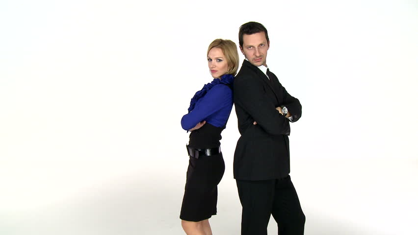 Young business couple posing. High definition video on white studio background.