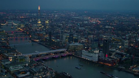 Panoramic aerial shot along the River Thames in Central London. Features well known landmarks including The Shard, City Financial District & Tower Bridge.