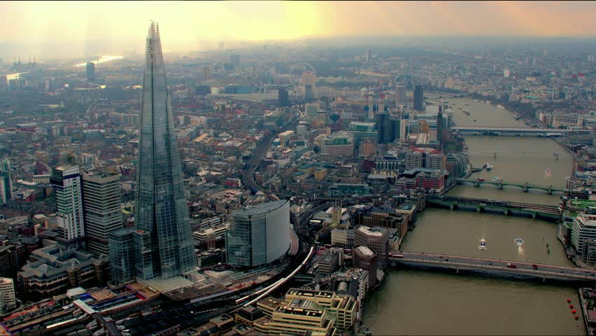 Panoramic aerial shot along the River Thames in Central London, UK. Features The Shard building, bridges and the Millennium Wheel / London Eye in the background. | Shutterstock HD Video #4835456