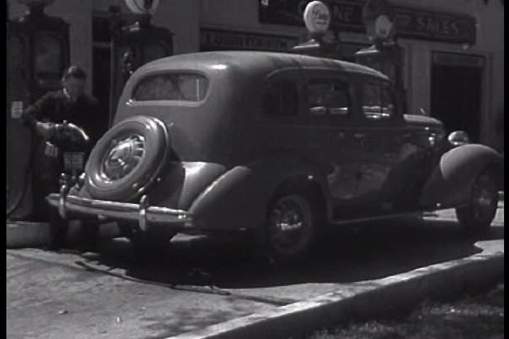 1930s - 1935 film combines live action and animation and discusses the importance of gasoline to a new automobile based economy. | Shutterstock HD Video #4836386