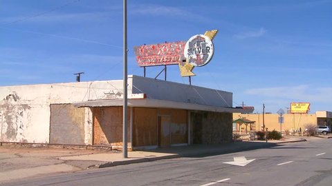 An abandoned liquor store sits in a modern ghost town near Boron, California.