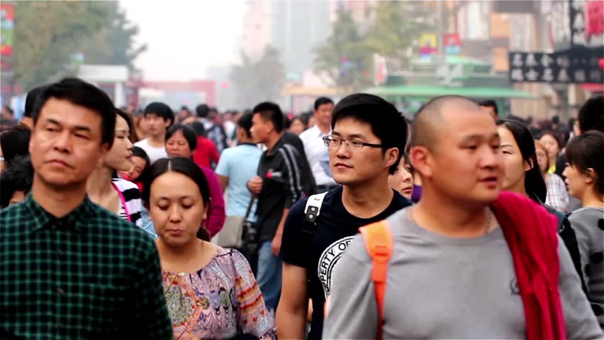 BEIJING, CHINA - OCTOBER 6, 2013: Thousands of visitors in Wangfujing Walking Street, Beijing, China