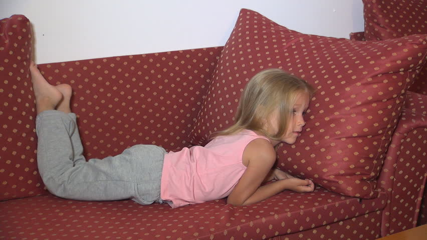Child Watching TV, Sleepy Little Girl Lying on Bed, Coach, Close Up, Children