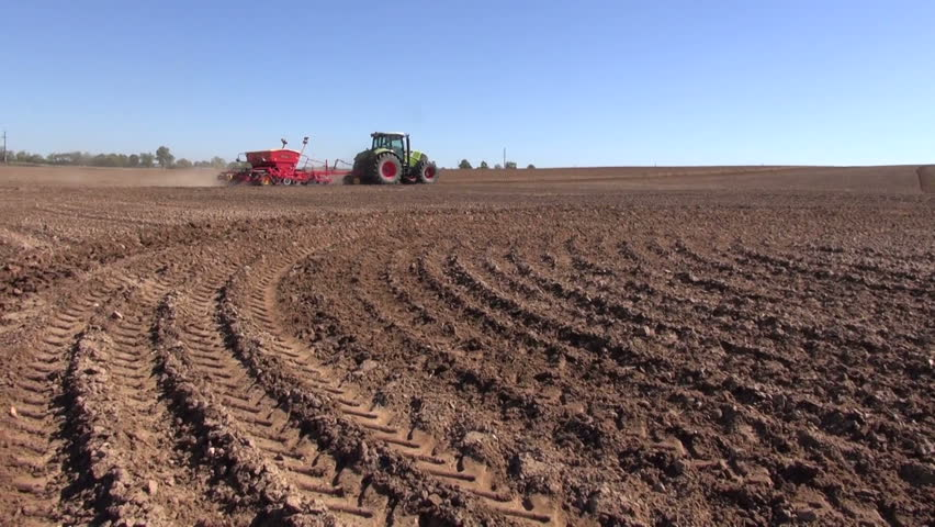 Agriculture tractor sowing seeds and cultivating field in autumn   Shutterstock HD Video #4935146