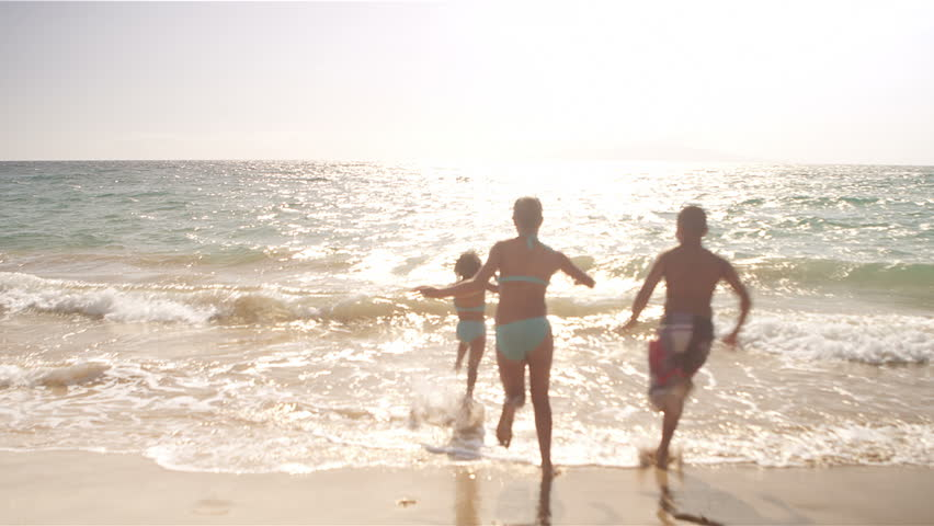 Three Kids Run Down The Beach And Into Ocean Water Stock Footage Video 4956416