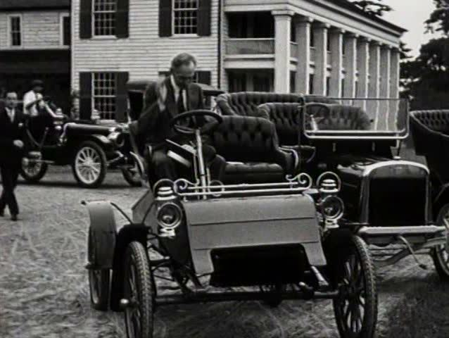 henry ford first model a. 1920s henry ford poses in one of his first model t cars and other later models stock footage video 4956716 shutterstock a i