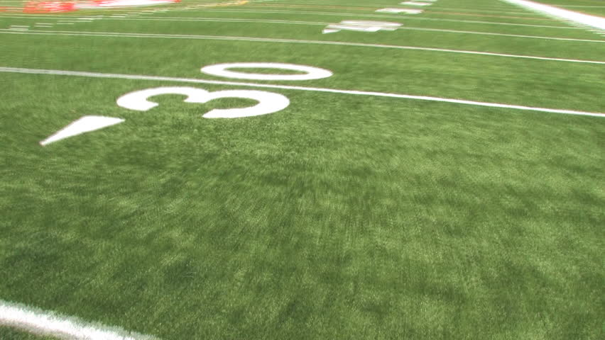 View of the astroturf while running 70 yards to the end zone. Shot using stabilizing Glidecam.