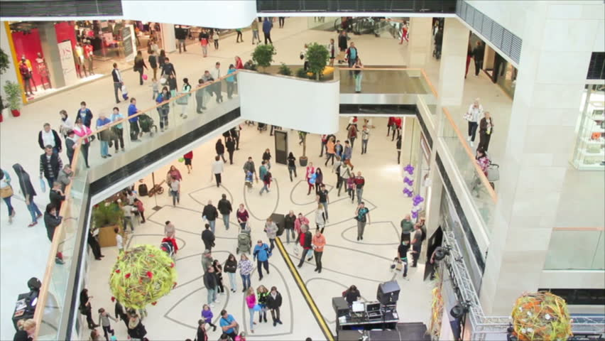 Slightly defocused crowd of walking people in the newly opened shopping mall