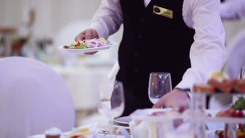 Waiter serves a festive table