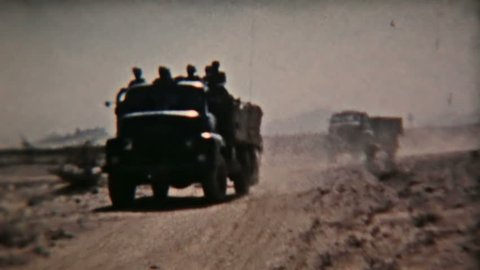 ADEN PROTECTORATE CIRCA 1960: Aden Protectorate British Army military convoy desert vintage film. Southern Arabia.  One of a kind private owned vintage and historic 8mm film. Now Republic of Yemen.