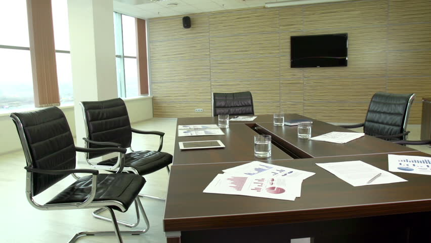 The interior view of a contemporary business office with financial documents lying on the table #5011145