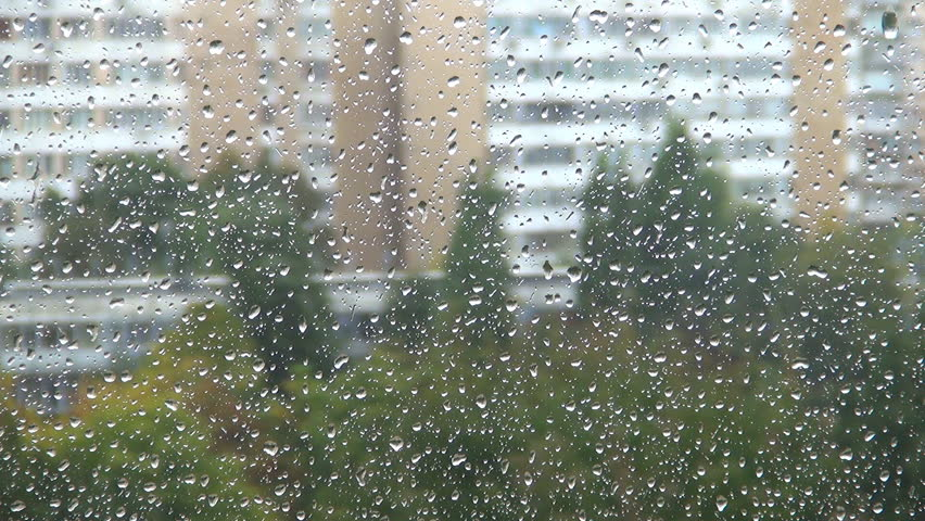Raining Outside On The Street And Water Drop On Windows At