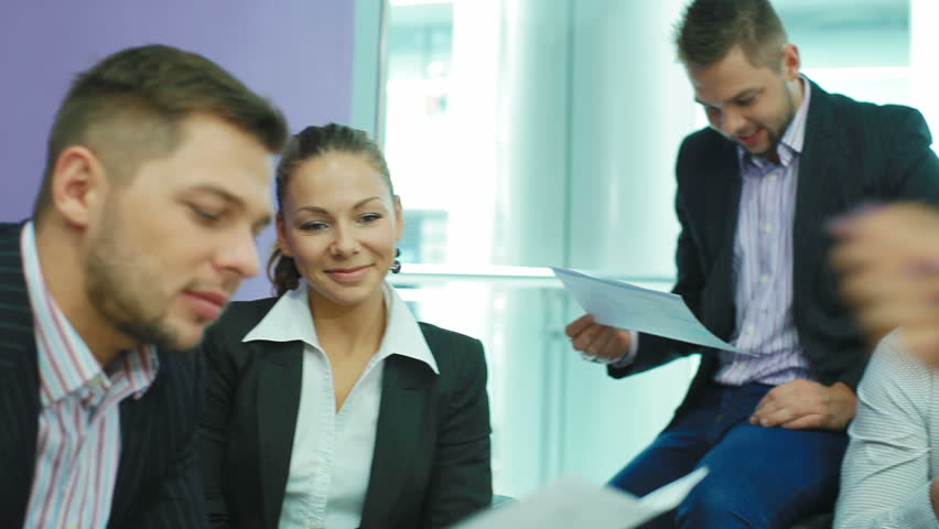 Female manager gives paper a team of professionals | Shutterstock HD Video #5026061