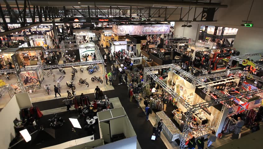 MILAN, ITALY - NOVEMBER 7: Panoramic view of people at the motorcycles exhibition area during EICMA, 71ST International Motorcycle Exhibition on November 7, 2013 in Milan, Italy.