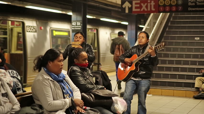 NEW YORK - NOVEMBER 3: Music Under New York in subway station on November 3, 2013 in New York. Music Under New York is a program of the MTA that schedules musical performances in the NYC Subway.
