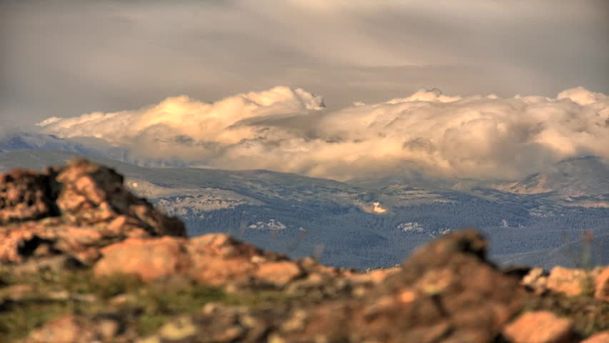 Time lapse with mountains & rolling clouds at Twin Sisters Peak in Rocky Mountain National Park, Colorado.